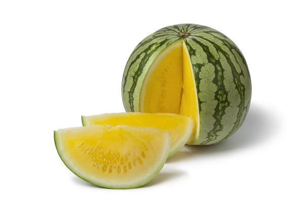 Seedless yellow watermelon on white background